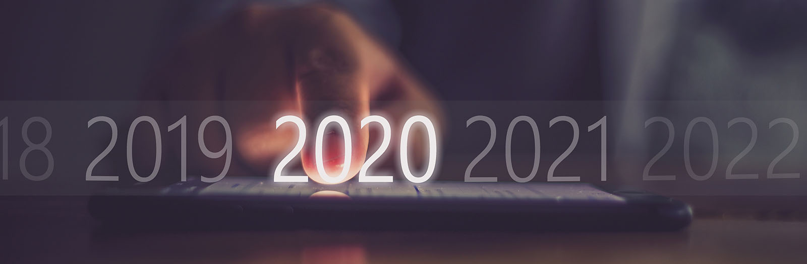 Photo of hand on a keyboard highlighting 2020