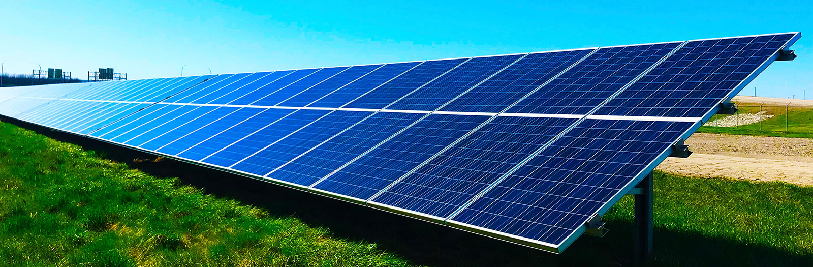 photo of solar panel on top of grass