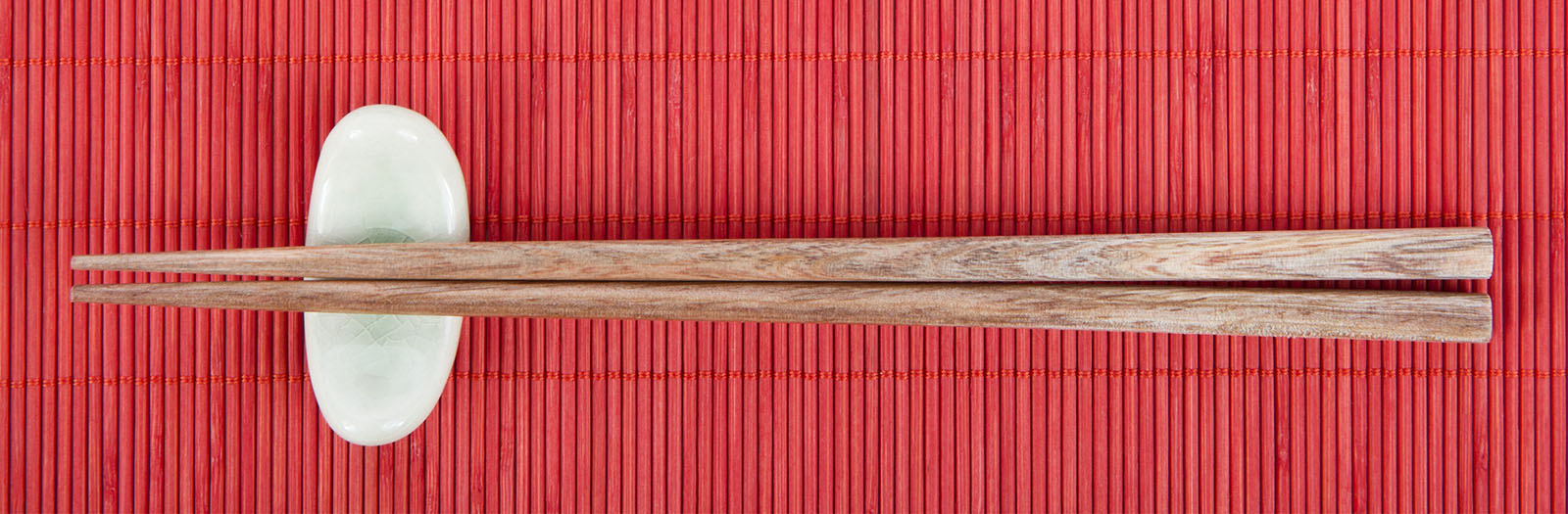 photo of bamboo chopsticks on a red place mat