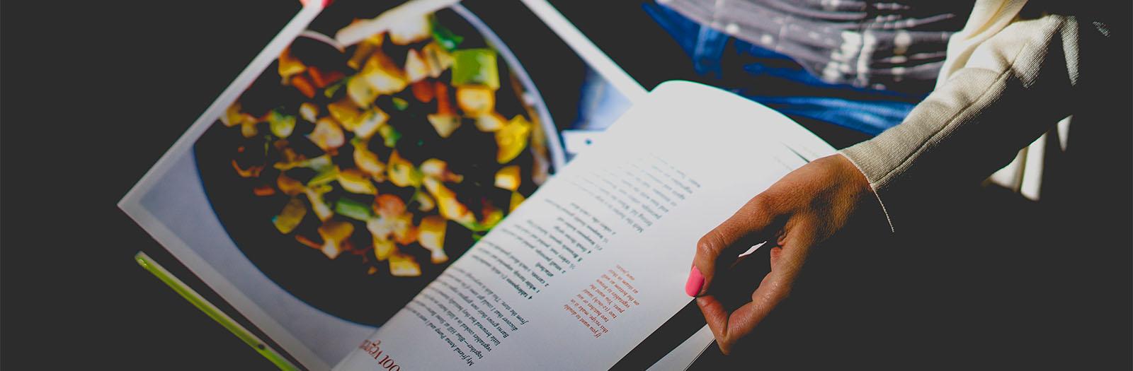 cookbook in hand