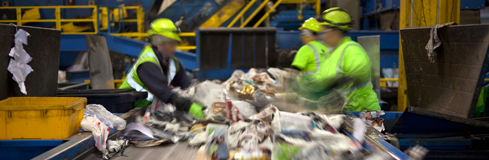 workers sorting recycling