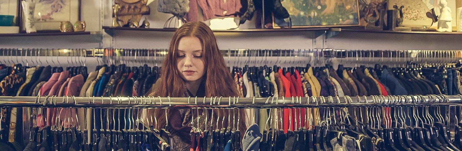 woman browsing through clothes