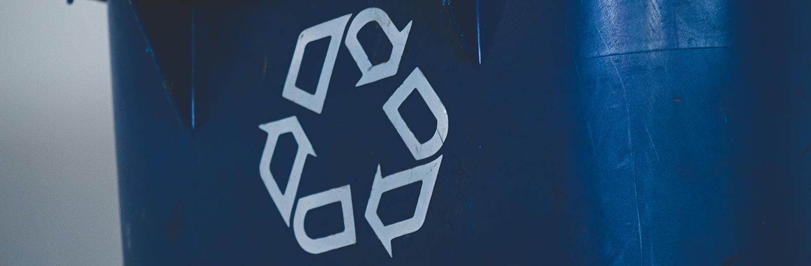 recycle symbol on blue bin