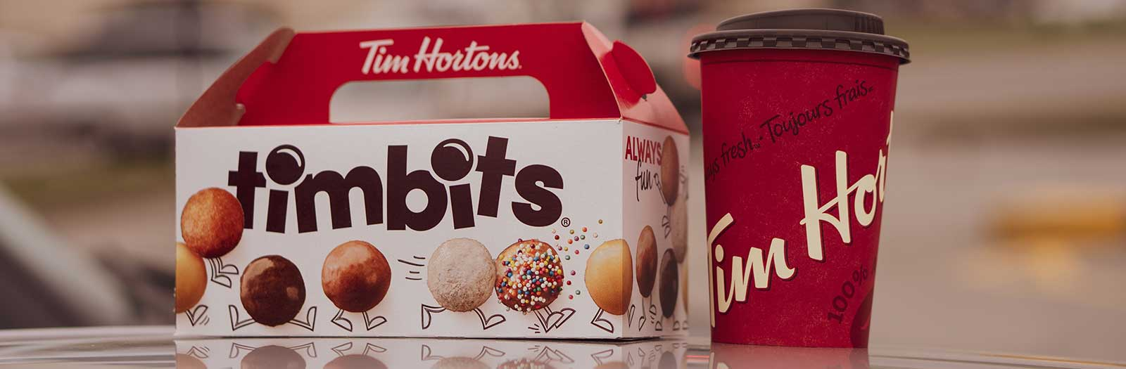 photo of a box of Tim Hortons timbits and a cup of Tim Hortons coffee