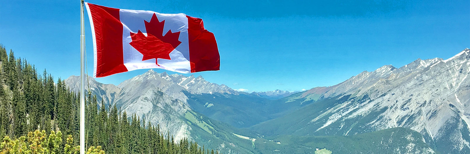 Canadian flag in the mountains