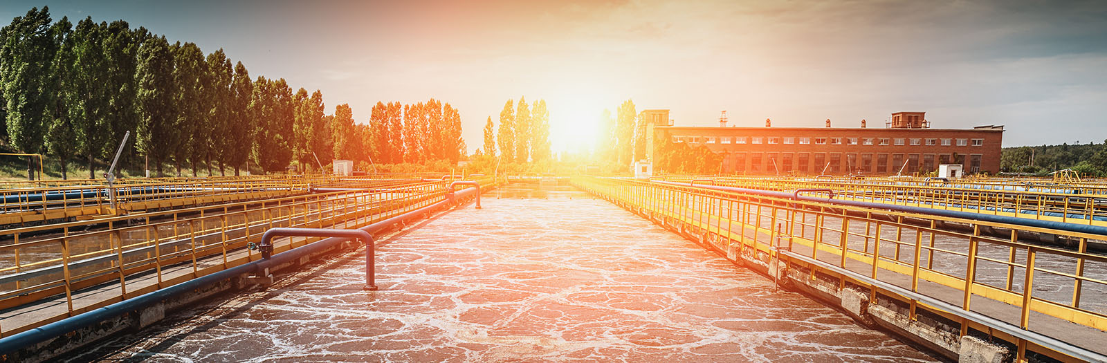 photo of wastewater treatment plant at sunset
